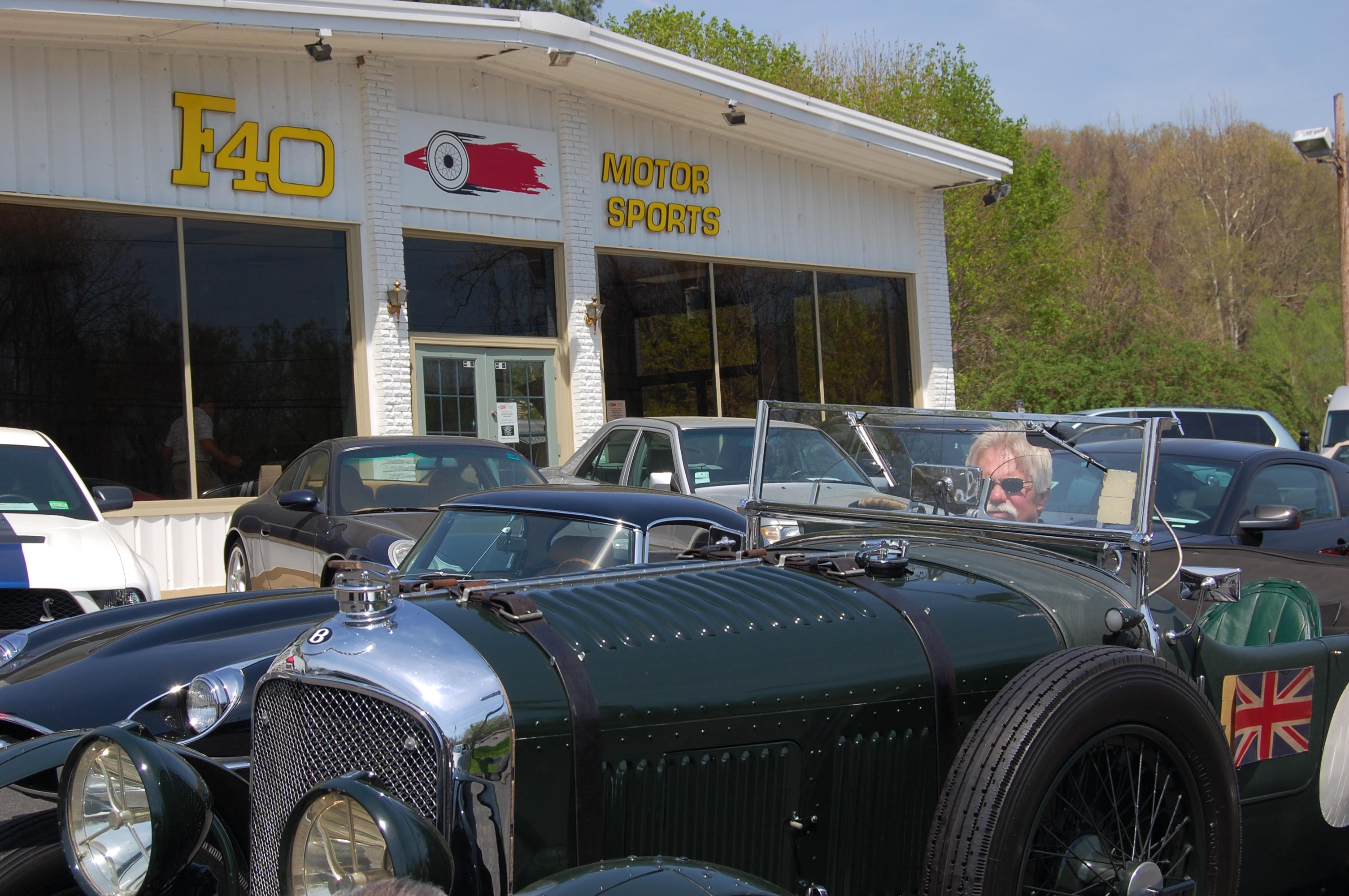collector cars wayne in bentley outside shop